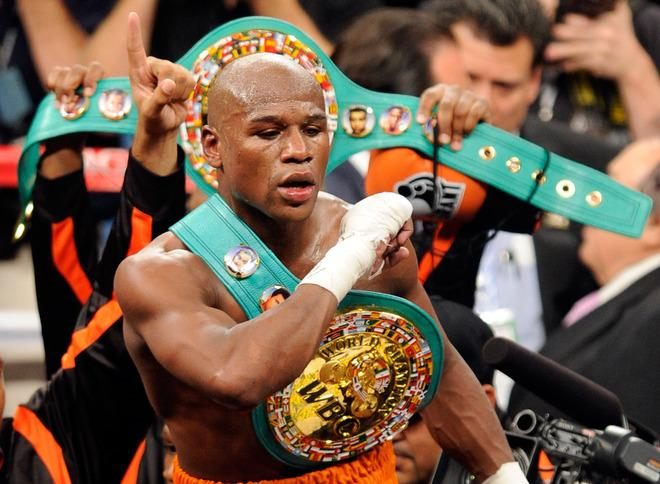 LAS VEGAS, NV - SEPTEMBER 17:  Floyd Mayweather Jr. celebrates his fourth-round knockout of Victor Ortiz to win the WBC welterweight title September 17, 2011 in Las Vegas, Nevada. It was reported that Floyd Mayweather Jr. has been sentenced to three months in jail after pleading guilty to a charge of misdemeanor battery domestic violence and no contest on two counts of harassment against an ex-girlfriend December 21, 2011.  (Photo by Ethan Miller/Getty Images)