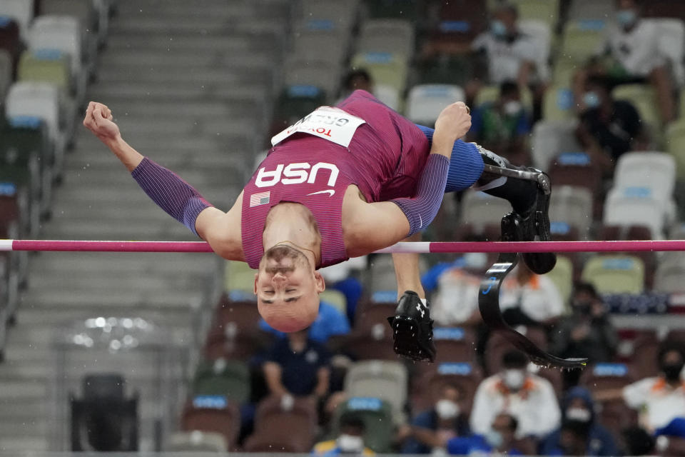 Sam Grewe of the United States competes in the men's high jump T63 final during the Tokyo 2020 Paralympics Games at the National Stadium in Tokyo, Japan, Tuesday, Aug. 31, 2021. (AP Photo/Eugene Hoshiko)