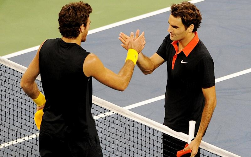 Juan Martin Del Potro (L) of Argentina shakes hands with Roger Federer of Switzerland - Credit: AFP/Getty Images