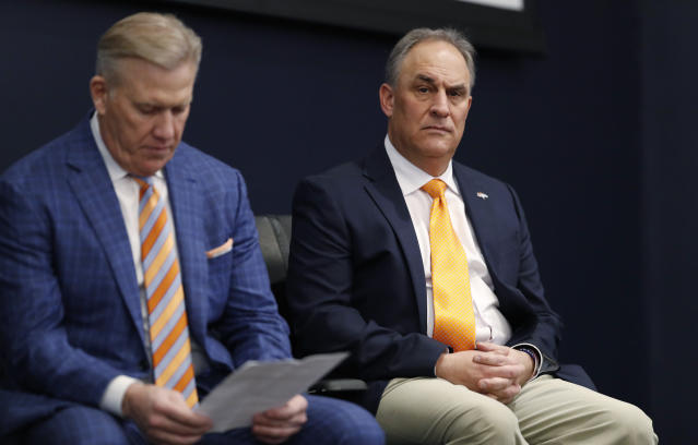 Denver Broncos new head coach Vic Fangio, right, waits to speak as general manager John Elway looks over his introductory notes during a news conference at the team's headquarters Thursday, Jan. 10, 2019, in Englewood, Colo. (AP Photo/David Zalubowski)