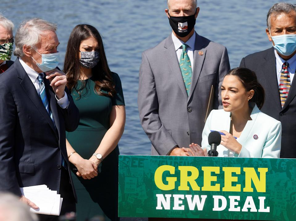 <p>US Rep Alexandria Ocasio-Cortez speaks as she and fellow Democratic lawmakers relaunch their 'Green New Deal' resolution on Capitol Hill in Washington, US, 20 April, 2021</p> (REUTERS)