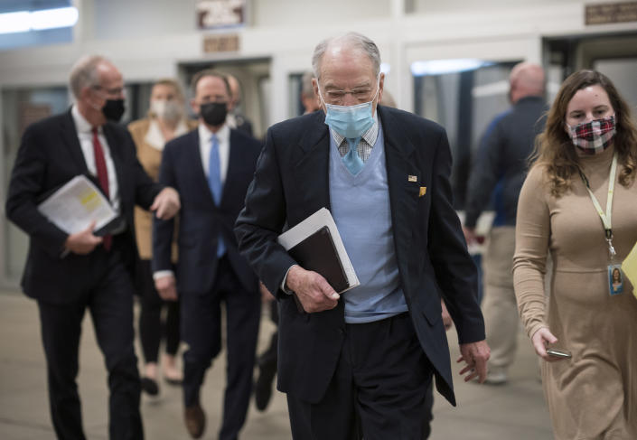 Sen. Chuck Grassley, R-Iowa, heads to the chamber as the Senate holds a voting marathon on the Democrats' $1.9 trillion COVID-19 relief bill that's expected to end with the chamber's approval of the measure, at the Capitol in Washington, Friday, March 5, 2021. (AP Photo/J. Scott Applewhite)