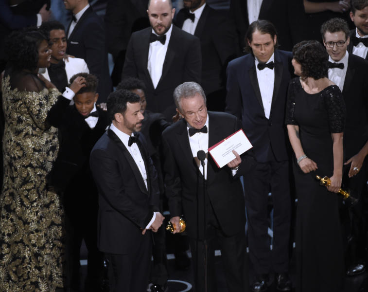 "FILE - In this Feb. 26, 2017 file photo, presenter Warren Beatty shows the envelope with the actual winner for best picture as host Jimmy Kimmel, left, looks on at the Oscars in Los Angeles. The winner was originally announced as ""La La Land,"" but was later corrected to ""Moonlight."" (Photo by Chris Pizzello/Invision/AP)"