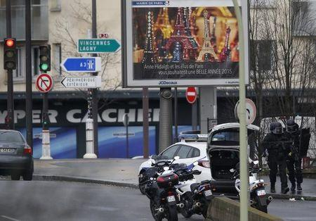 French intervention police are seen at the scene of a hostage taking at a kosher supermarket in eastern Paris January 9, 2015. REUTERS/Charles Platiau