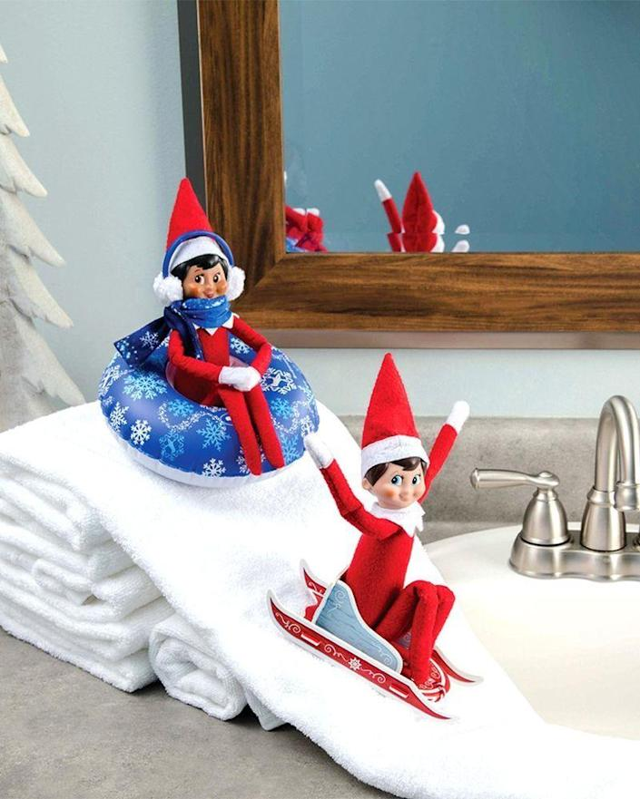 """<p>Just because you can't go on your annual ski trip, doesn't mean your Elf can't hit the slopes! A small pile of hand towels makes for the perfect sledding hill.</p><p><strong>Get the tutorial at <a href=""""https://elfontheshelf.com/elf-ideas/snow-slide-mountain/"""" rel=""""nofollow noopener"""" target=""""_blank"""" data-ylk=""""slk:Elf on the Shelf"""" class=""""link rapid-noclick-resp"""">Elf on the Shelf</a>.</strong> </p>"""