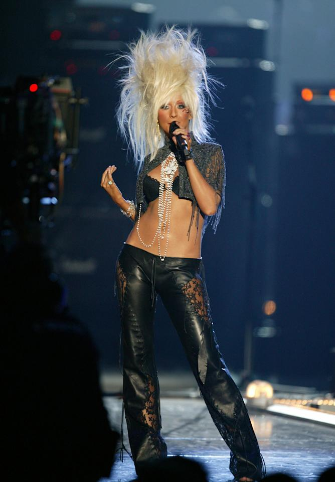 Christina Aguilera  It's always interesting how fashions that were so cool at the time become grossly laughable just a few years later. But I have a feeling that this look wasn't cool at the time either. Christina Aguilera's frightening wig at the 2003 MTV Europe Music Awards looks like a bad case of electrocution that hopefully shocked some fashion sense into her. Leave the big, Aquanet hair to the headbangers and Tina Turner next time, please?