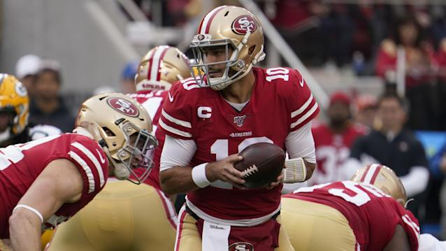 San Francisco 49ers quarterback Jimmy Garoppolo (10) hands off during the first half of the NFL NFC Championship football game against the Green Bay Packers Sunday, Jan. 19, 2020, in Santa Clara, Calif. (AP Photo/Tony Avelar)