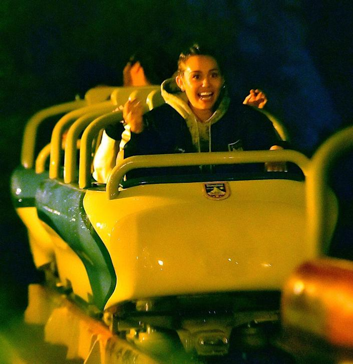 """<p>You didn't think the """"Can't Be Tamed"""" singer would frown her way through a roller coaster ride, did you? No way. Miley enjoyed the adrenaline rushes provided by the rides at Disneyland. (Photo: Fern/Splash News) </p>"""