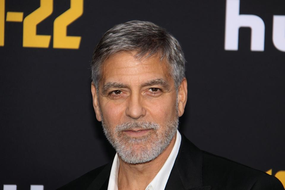 "George Clooney wears a black suit at the premiere of ""Catch-22"" in 2019"