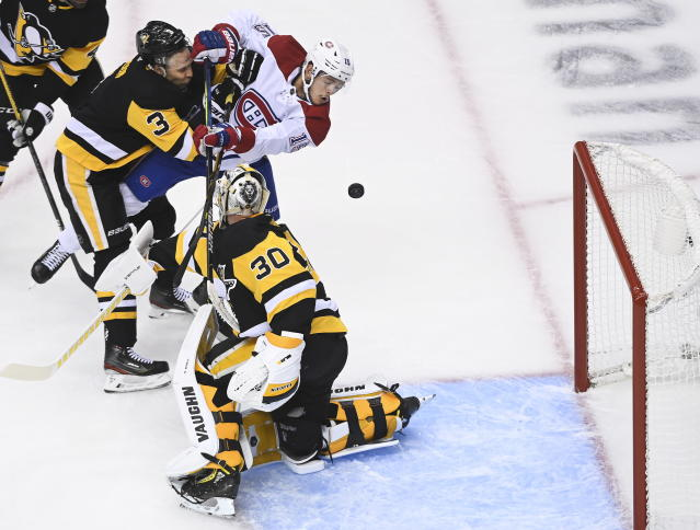 Montreal Canadiens center Jesperi Kotkaniemi (15) scores on Pittsburgh Penguins goaltender Matt Murray (30) as Penguins' Jack Johnson (3) defends during the first period of an NHL hockey playoff game in Toronto, Saturday, Aug. 1, 2020. (Nathan Denette/The Canadian Press via AP)