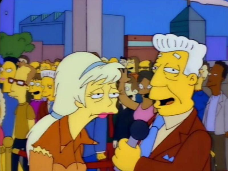 A Kent Brockman lookalike can be seen in the crowd while the newscaster interviews Lurleen (Photo: Fox)
