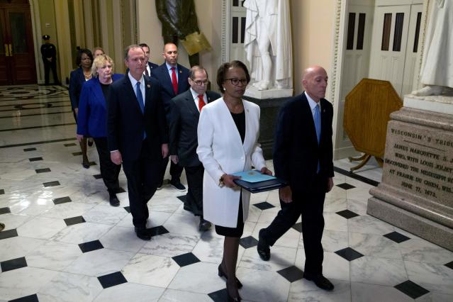 House sergeant at arms Paul Irving, front right, and House clerk Cheryl Johnson carry the articles of impeachment to the Senate followed by the impeachment managers Wednesday. (Photo: Jose Luis Magana/POOL/AFP via Getty Images)