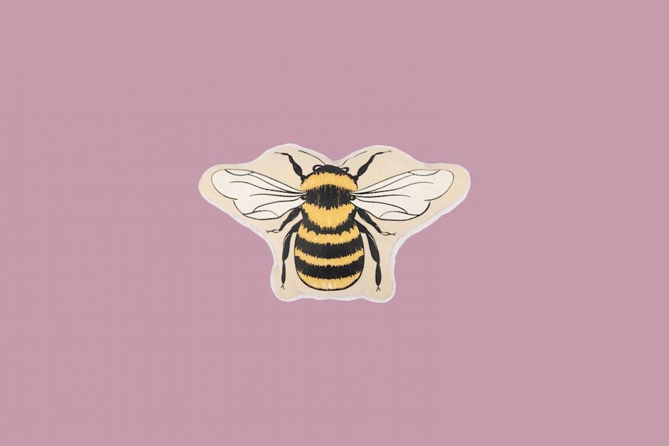 """<p>Who wouldn't want this bright buzzing toy? Complete with a sturdy canvas front and berber fleece backing, this friendly bee will make all the pups smile. Plus, you can feel good about your purchase: 10% of each sale of this toy is donated to The Honeybee Conservancy. Saving the bees will help save our planet.</p> <p><strong><em>Shop Now:</em></strong><em> Harry Barker Honey Bee Canvas Dog Toy, $14, </em><a href=""""https://harrybarker.com/collections/play/products/honey-bee-canvas-dog-toy"""" rel=""""nofollow noopener"""" target=""""_blank"""" data-ylk=""""slk:harrybarker.com"""" class=""""link rapid-noclick-resp""""><em>harrybarker.com</em></a><em>.</em></p>"""