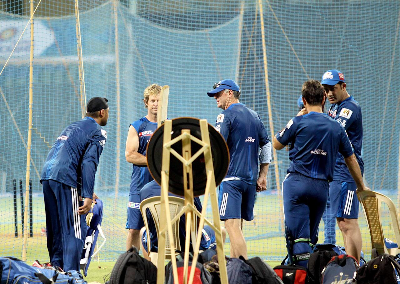 Mumbai Indians head coach John Wright and fielding coach Jonty Rhodes have a chat with Harbhajan Singh during a nets session at the Wankhede Stadium on 8 April 2013. (Yogen Shah)
