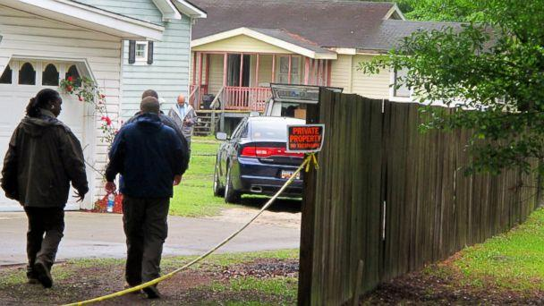 PHOTO: Investigators work at a scene of a shooting in Hollywood, S.C., May 7, 2015. (Bruce Smith/AP Photo)
