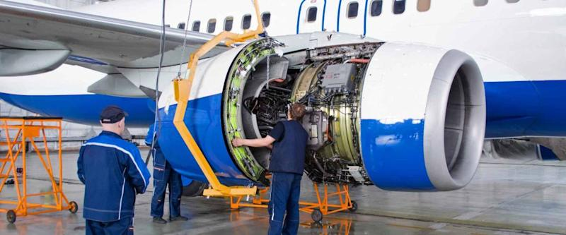 Replacing the engine on the airplane, working people. Concept maintenance of aircraft