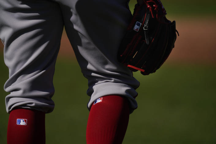 Boston Red Sox pitcher Darwinzon Hernandez (63) holds a glove and waits to workout during spring training baseball practice on Monday, Feb. 22, 2021, in Fort Myers, Fla. (AP Photo/Brynn Anderson)