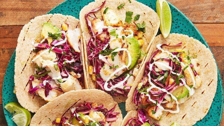 """<p>A classic fish taco is something we all need to be able to master. This is our perfect recipe: The fish — we use cod, but any flaky variety works — marinates in a mixture of lime juice, chilli powder, and cumin that will become your standard. </p><p>Get the <a href=""""https://www.delish.com/uk/cooking/recipes/a28869036/easy-fish-taco-recipe/"""" rel=""""nofollow noopener"""" target=""""_blank"""" data-ylk=""""slk:Perfect Fish Tacos"""" class=""""link rapid-noclick-resp"""">Perfect Fish Tacos</a> recipe. </p>"""