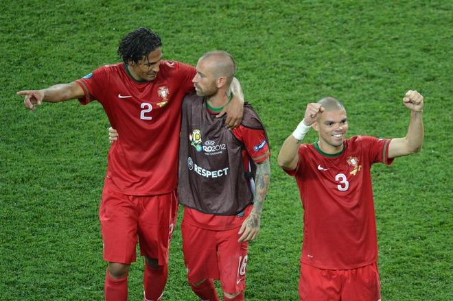 Portuguese defender Pepe (R) celebrates with teammates at the end of the Euro 2012 football championships match Portugal vs. Netherlands, on June 17, 2012 at the Metalist stadium in Kharkiv. Portugal won 2 to 1.         AFP PHOTO / SERGEI SUPINSKYSERGEI SUPINSKY/AFP/GettyImages
