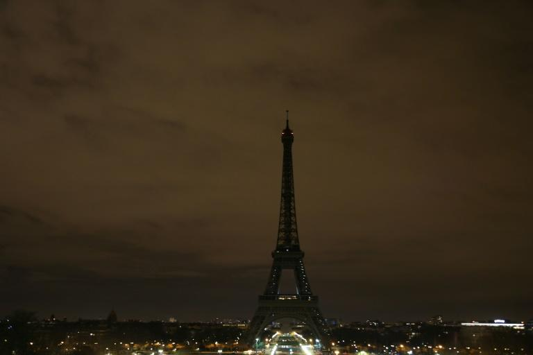 The Eiffel Tower had already turned its lights off on Tuesday night after a series of suicide blasts in Baghdad killed at least 42