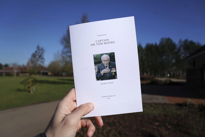 A view of the Order of Service for the funeral of Captain Tom Moore at Bedford Crematorium, in Bedford, England, Saturday, Feb. 27, 2021. Tom Moore, the 100-year-old World War II veteran who captivated the British public in the early days of the coronavirus pandemic with his fundraising efforts died, Tuesday Feb. 2, 2021. (Joe Giddens/Pool Photo via AP)