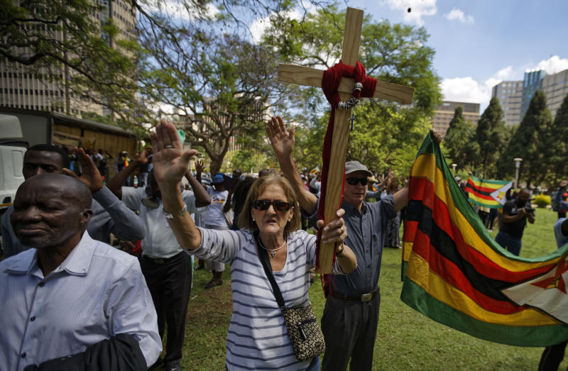 <p> Zimbabweans raise their hands in prayer during a Christian peace and prayer rally in central Harare, Zimbabwe Monday, Nov. 20, 2017. Longtime President Robert Mugabe ignored a midday deadline set by the ruling party to step down or face impeachment proceedings, while Zimbabweans stunned by his lack of resignation during a national address vowed more protests to make him leave. (AP Photo/Ben Curtis) </p>