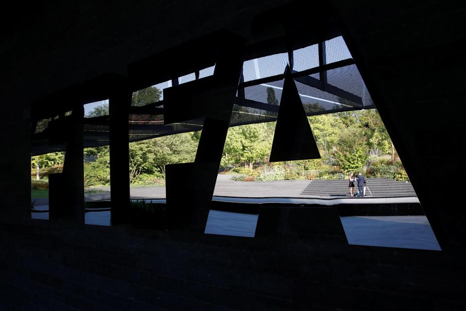 General view of the FIFA logo before the start of the draw (Reuters)