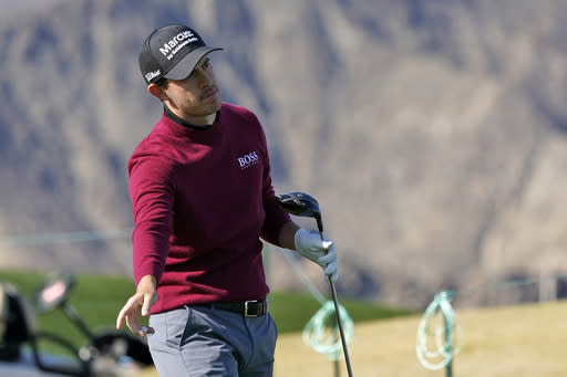 Patrick Cantlay watches his tee shot on the first hole during the final round of The American Express golf tournament on the Pete Dye Stadium Course at PGA West, Sunday, Jan. 24, 2021, in La Quinta, Calif. (AP Photo/Marcio Jose Sanchez)