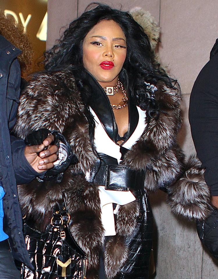 """Rapper Lil Kim was in NYC to promote her comeback album. She stopped by MTV Studios wearing a big fur coat, bright red lipstick, and batty eyelashes. Pictured: Kimberly """"Lil Kim"""" Jones Ref: SPL506991  060313  Picture by: Splash News   Splash News and Pictures Los Angeles:310-821-2666 New York:212-619-2666 London:870-934-2666 photodesk@splashnews.com"""