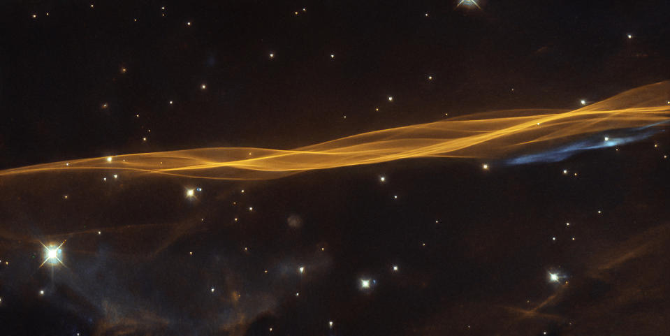 This brilliant streak of light is a small section of the Cygnus supernova blast wave, as spotted by the Hubble Space Telescope. The blast, which is about 2,400 light-years away, was from a supernova explosion that tore apart a dying star 20 times more massive than our sun between 10,000 and 20,000 years ago.