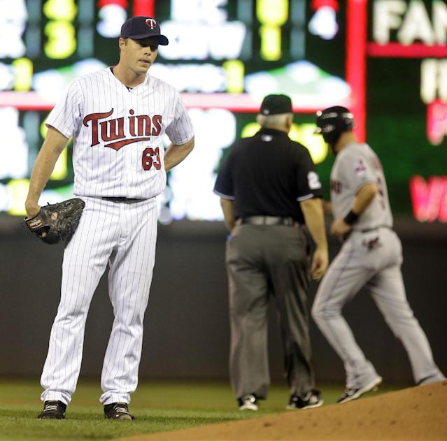 Minnesota Twins pitcher Andrew Albers, left, steps away from the mound as Cleveland Indians' Ryan Rayburn, right, advances to second on a balk call during the fourth inning of a baseball game, Thursday, Sept. 26, 2013, in Minneapolis. (AP Photo/Jim Mone)