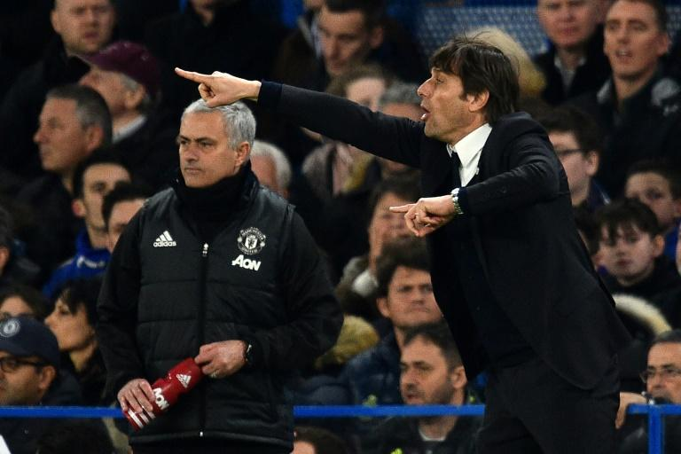 Chelsea boss Antonio Conte (right) and Manchester United manager Jose Mourinho on the touchline at Stamford Bridge in London on March 13, 2017