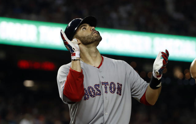 Boston Red Sox' J.D. Martinez celebrates his two-run home run during the ninth inning of an interleague baseball game at Nationals Park Tuesday, July 3, 2018, in Washington. The Red Sox won 11-4. (AP Photo/Alex Brandon)