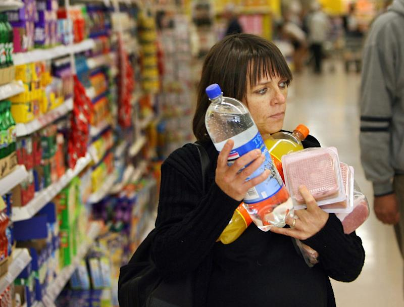 A woman carries her shopping at the Osterley branch of Tesco in London, 03 October 2006.