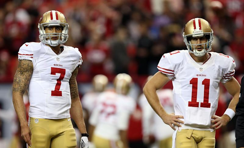 Quarterbacks Colin Kaepernick and quarterback Alex Smith of the San Francisco 49ers warm up before taking on the Atlanta Falcons in the NFC Championship game at the Georgia Dome on January 20, 2013, in Atlanta, Georgia.