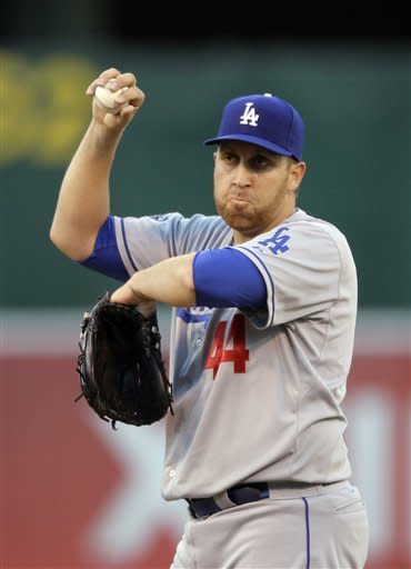 Los Angeles Dodgers starting pitcher Aaron Harang reacts on the mound after the Oakland Athletics scored their third run in the first inning of their baseball game in Oakland, Calif., Tuesday, June 19, 2012. (AP Photo/Eric Risberg)