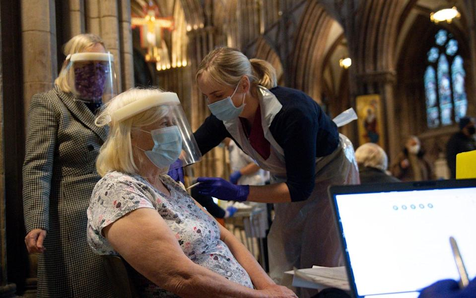 Audrey Elson, 84, receives an injection of the Oxford/AstraZeneca coronavirus vaccine at Lichfield Cathedral, Staffordshire. PA Photo. Picture date: Friday January 15, 2021. See PA story HEALTH Coronavirus. - Jacob King/PA Wire