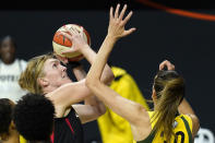 Las Vegas Aces center Carolyn Swords (4) shoots over Seattle Storm forward Breanna Stewart (30) during the first half of Game 1 of basketball's WNBA Finals Friday, Oct. 2, 2020, in Bradenton, Fla. (AP Photo/Chris O'Meara)