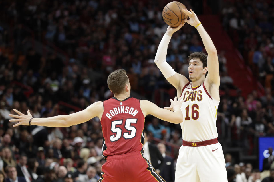 Cleveland Cavaliers forward Cedi Osman (16) passes past Miami Heat guard Duncan Robinson (55) during the first half of an NBA basketball game, Saturday, Feb. 22, 2020, in Miami. (AP Photo/Wilfredo Lee)