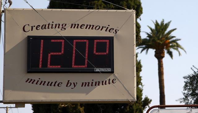 <p>A local temperature sign reads 120-degrees as temperatures climb to near-record highs, June 20, 2017, in Phoenix. (Ross D. Franklin/AP) </p>