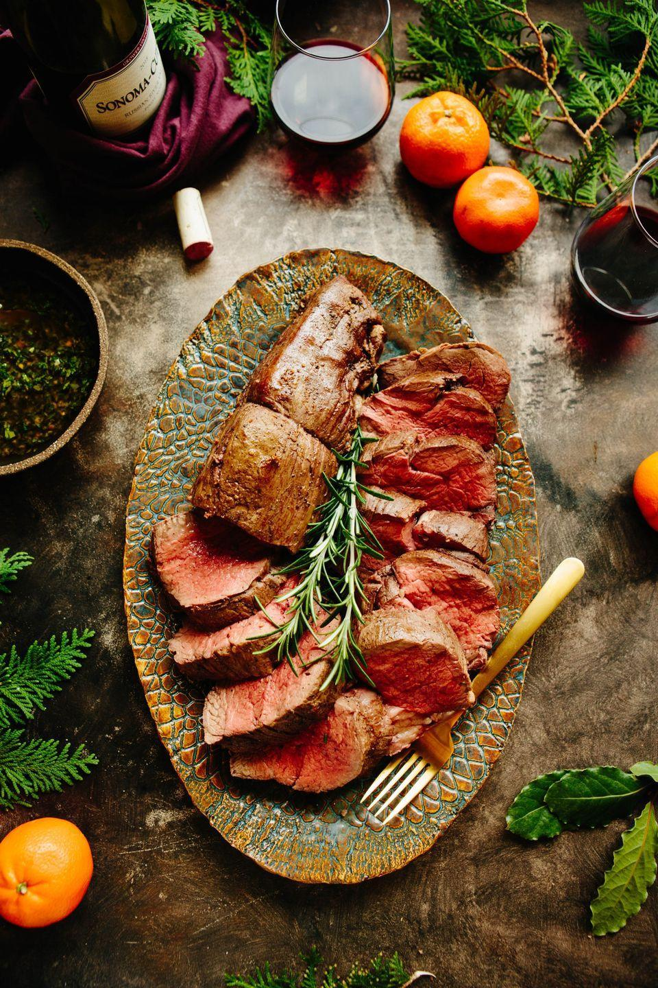 """<p>A beef tenderloin makes an incredible main course, especially if you're hosting a smaller dinner party. This recipe also gives steps to making a bordelaise sauce and a Chimichurri sauce.</p><p><strong>Get the recipe at <a href=""""https://coleycooks.com/whole-roasted-beef-tenderloin/"""" rel=""""nofollow noopener"""" target=""""_blank"""" data-ylk=""""slk:Coley Cooks"""" class=""""link rapid-noclick-resp"""">Coley Cooks</a>.</strong> </p>"""