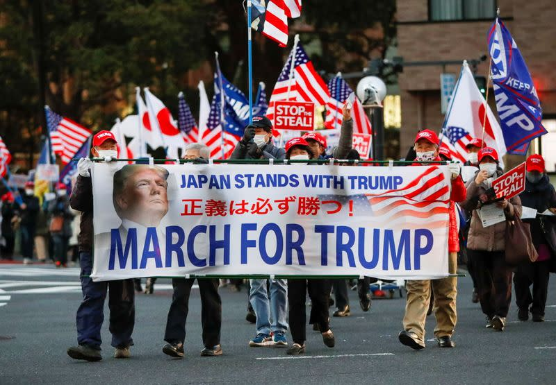 Supporters of U.S. President Trump march ahead of the inauguration of President-elect Biden, in Tokyo