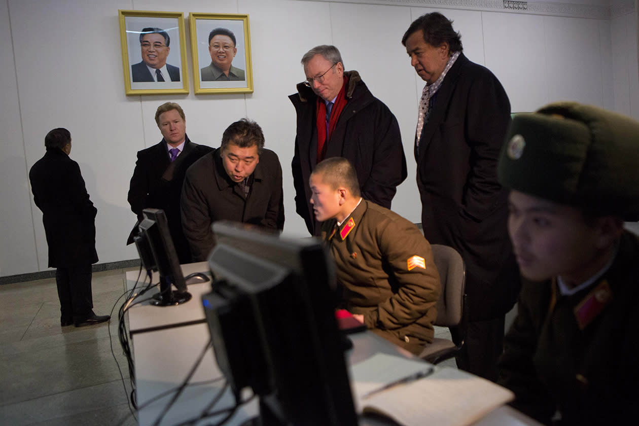 Executive Chairman of Google, Eric Schmidt, back row left, and former Governor of New Mexico Bill Richardson, back row right, look at North Korean soldiers working on computers at the Grand Peoples Study House in Pyongyang, North Korea.