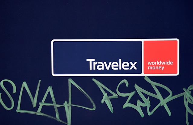 Signage with graffiti next to it is seen on a branch of Travelex Currency Exchange in London, Britain, January 8, 2020. REUTERS/Toby Melville