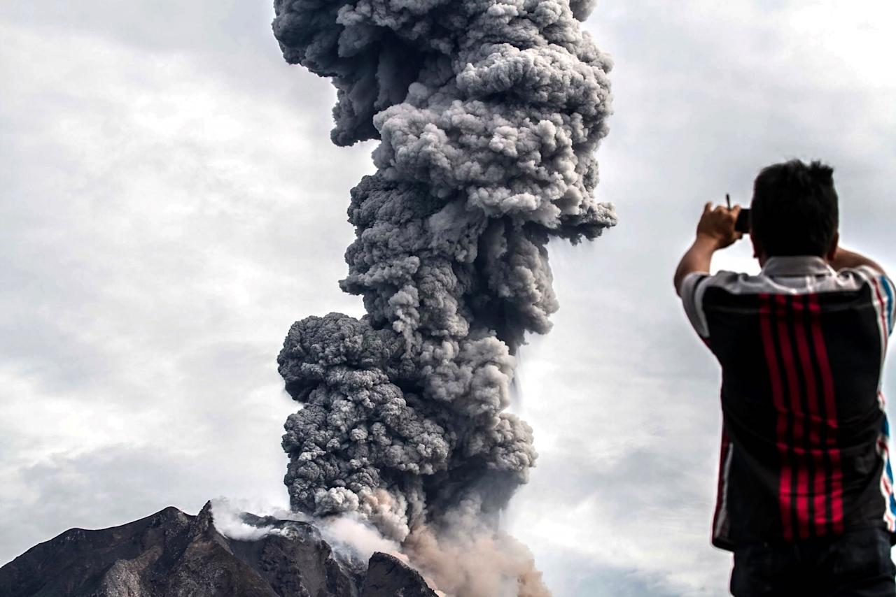 <p></p><p><span>A man takes a picture of the Mount Sinabung eruption in North Sumatra, Indonesia (Rex features)</span> </p><p></p>
