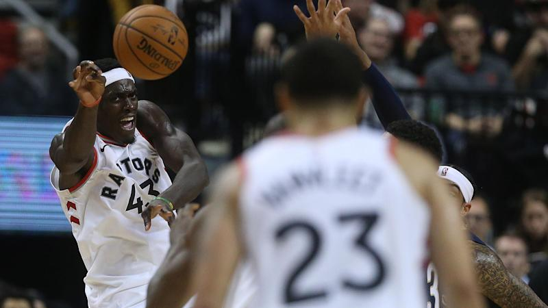 TORONTO, ON- OCTOBER 22 - Toronto Raptors forward Pascal Siakam (43) makes a pass to Toronto Raptors guard Fred VanVleet (23) as the Toronto Raptors open the season against the New Orleans Pelicans with a 130-122 overtime win at Scotiabank Arena in Toronto. October 22, 2019. (Steve Russell/Toronto Star via Getty Images)