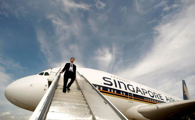 A Singapore Airlines staff member walks down a set of stairs from an Airbus A380 in Sydney. (REUTERS/Tim Wimborne/File Photo)