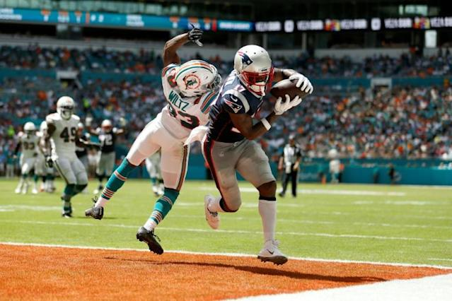 New England Patriots receiver Antonio Brown hauls in a 20-yard touchdown pass from Tom Brady in a 43-0 NFL victory over the Miami Dolphins (AFP Photo/Michael Reaves)