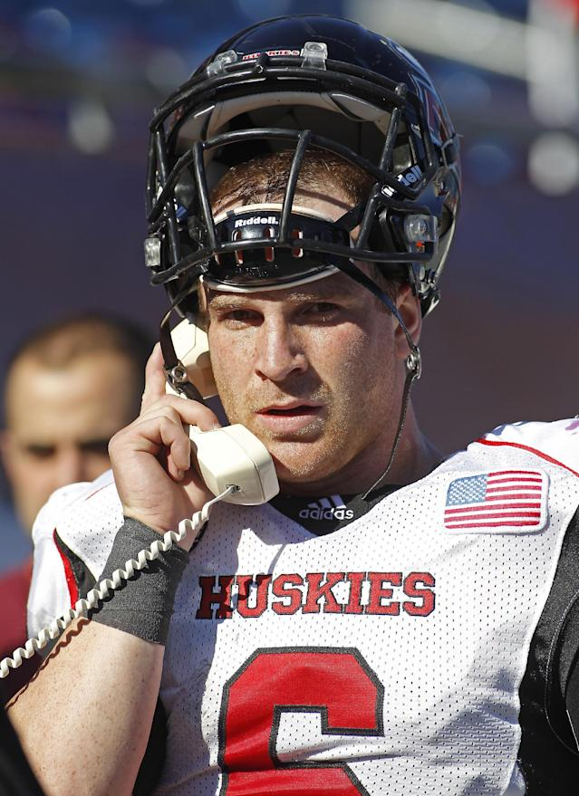 Northern Illinois quarterback Jordan Lynch (6) talks on the phone following one of his touchdowns during the first half of an NCAA football game against Massachusetts in Foxborough, Mass., Saturday, Nov. 2, 2013. Northern Illinois defeated Massachusetts, 63-19. (AP Photo/Stew Milne)