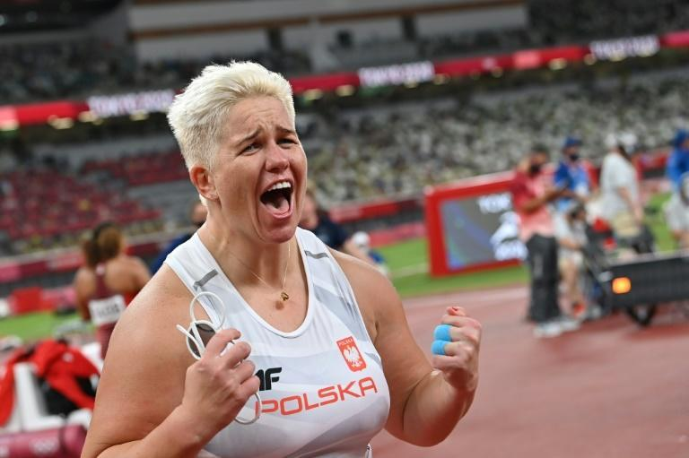 Poland's Anita Wlodarczyk made history in becoming the first female athlete to win the same event three times as she triumphed in the hammer